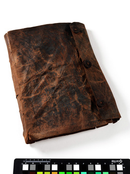 Image of the psalter in its leather wrap after conservation.